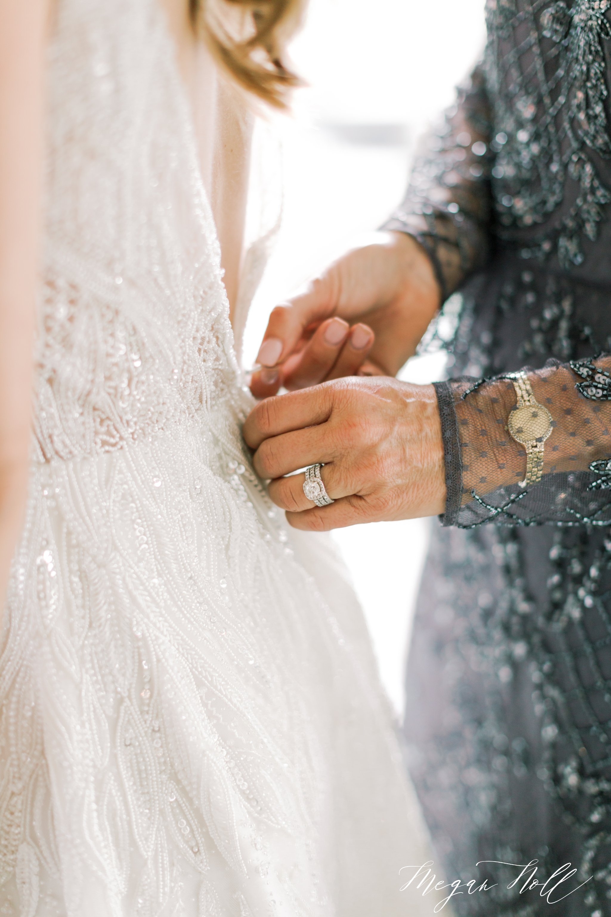 Close up of Vicky Sena helping her daughter into her Enaura wedding dress