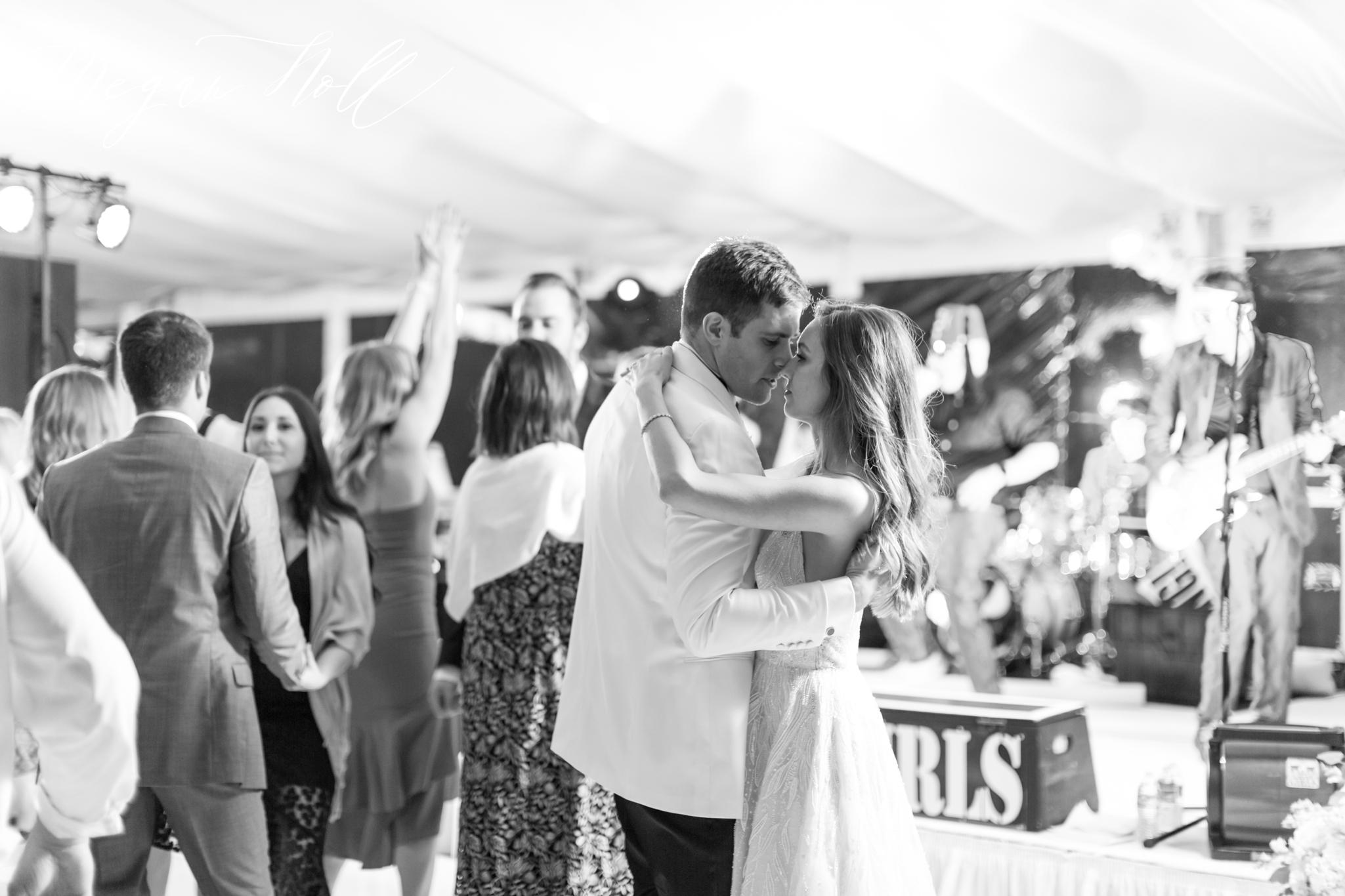 Bride and groom slow dancing together