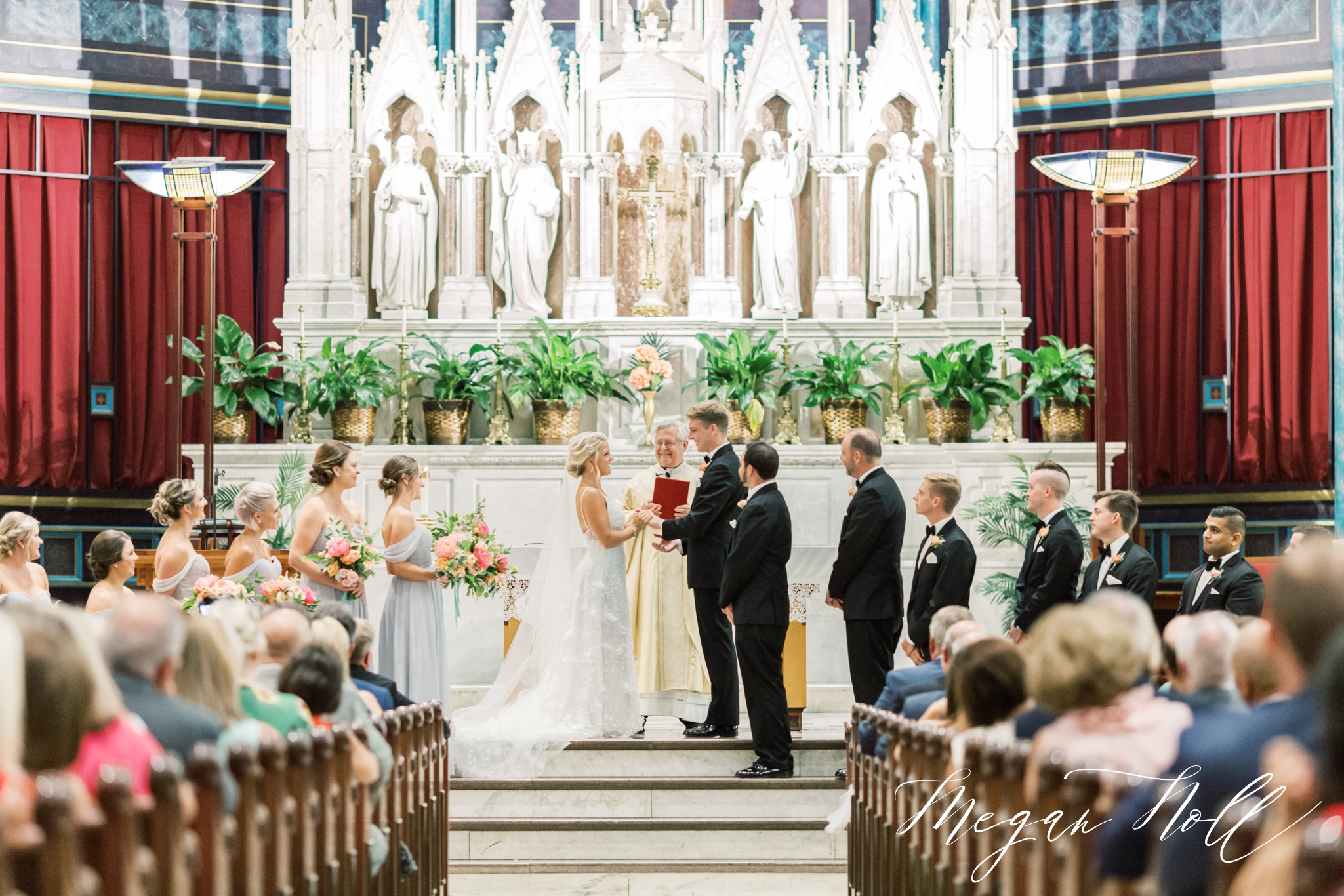 Exchanging vows for Cincinnati Wedding at Saint Xavier