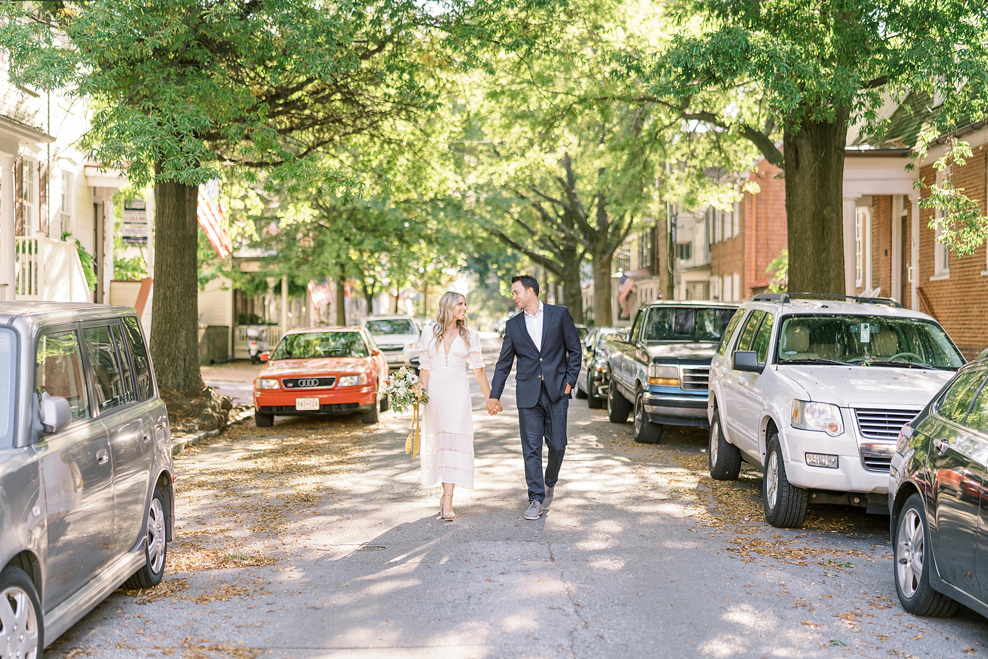 Couple poses for engagement photos in the streets of downtown Annapolis